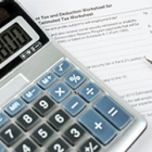 Tax documents with a calculator